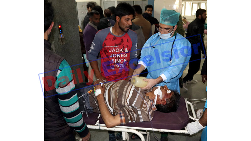 A civilian injured in grenade blast being admitted in a hospital in Srinagar on Monday. —Excelsior/Shakeel