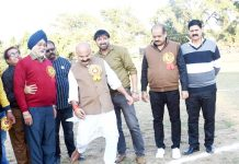 Senior BJP leader Yudhvir Sethi testing his soccer skills at GGM Science College Football ground in Jammu.