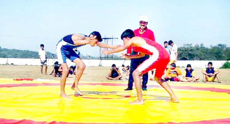 Wrestlers in action during Inter District State Level Tournament at Samba on Saturday.