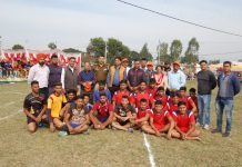 Winner team players posing for group photograph with SDM Marh Tariq Naik and other dignitaries.