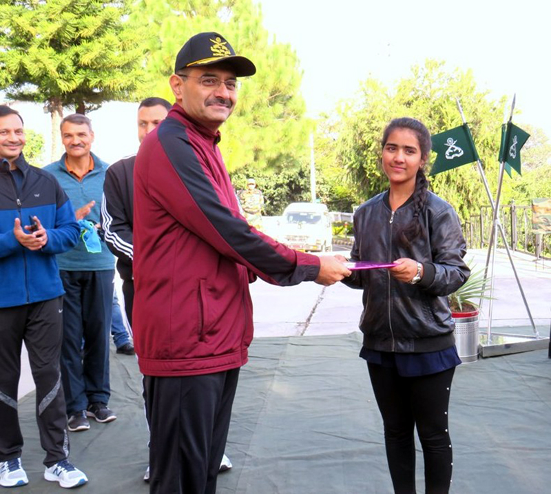 Major General P S Bajwa, GOC Romeo Force felicitating a winner of 'Cycle Expedition'.