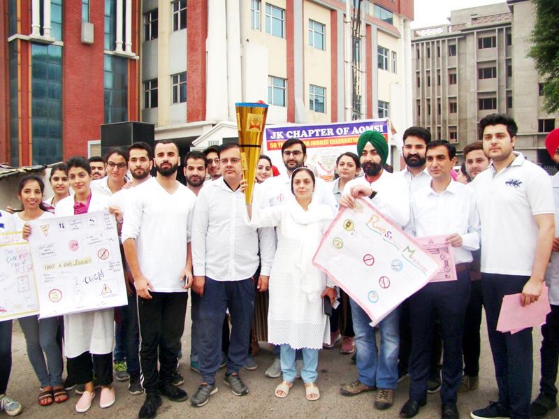 IGGDC Jammu's Department of Oral and Maxillofacial Surgery Department and others during Walkathon in Jammu on Sunday.