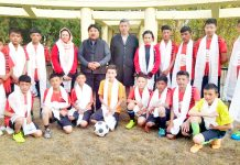 Selected footballers posing for group photograph with Chairman/CEC Gyal P Wangyal and others at Leh.