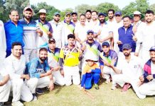 Players posing for a group photograph during a match between Media XI and DYSS XI in Jammu on Sunday.