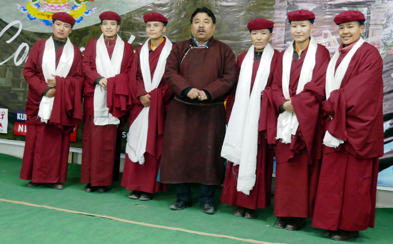 Kung Fu Nuns posing for group photograph with Hill Council Chairman Gyal P Wangyal during felicitation event at Leh. -Excelsior/Morup Stanzin