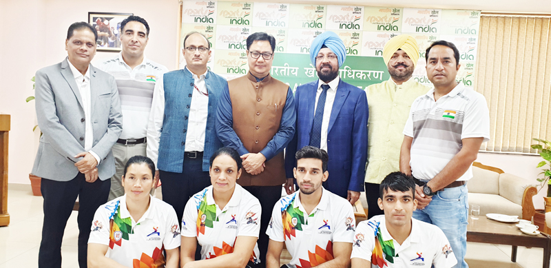 Wushu medallists and coaches posing along with Union Sports Minister, Kiran Rijiju and other dignitaries during felicitation function in Delhi.