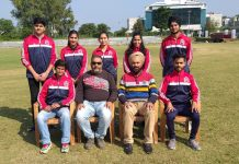 JU shooters posing for group photograph with Dr Daud Iqbal Baba Director, Directorate of Sports and Physical Education, University of Jammu.