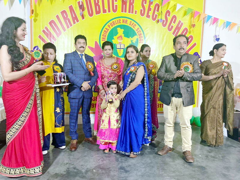 Management of Indira Public Higher Secondary School Shant Nagar Janipur and Indira Kids Play Way School awarding L KG student Aamaira Raina for participating in cultural items during Annual Prize Distribution function.