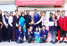 Winners of Literary Fest posing along with dignitaries and officials at GD Goenka Public School in Jammu.
