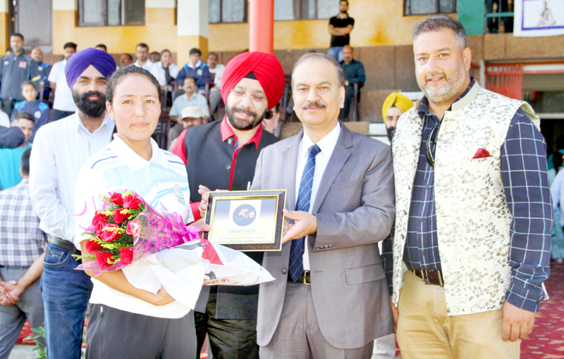 Vice Chancellor JU, Prof Manoj Dhar honouring Tsetan Dolma in Jammu on Thursday.