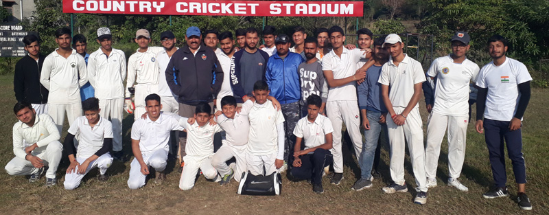 Teams posing for a group photograph during U-16 Cricket Tournament at Country Cricket Stadium in Jammu.