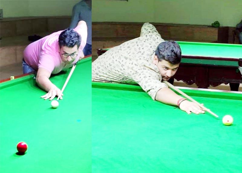 Cueists Karan Mengi and Vansh Gupta aiming at target during their matches in Senior Billiards at Billiards Hall, MA Stadium, Jammu on Wednesday. -Excelsior/Rakesh