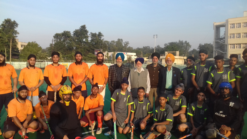 Winners posing along with dignitaries and officials during a match of 5th Baba Banda Singh Memorial Hockey Tournament.