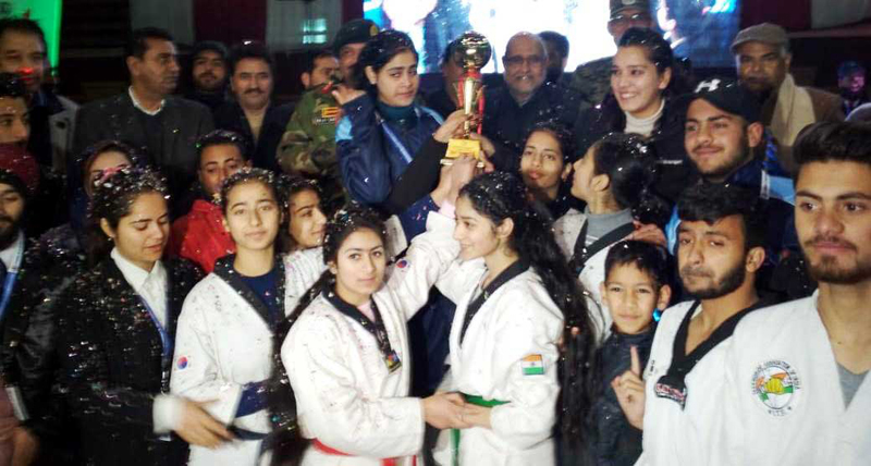 Winners of 3-day Khelo Kashmir Games receiving trophy during concluding ceremony in Srinagar.