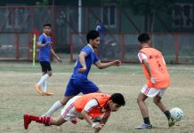 Players in action during a match of Football Tournament at GGM Science College Football ground in Jammu. —Excelsior/Rakesh