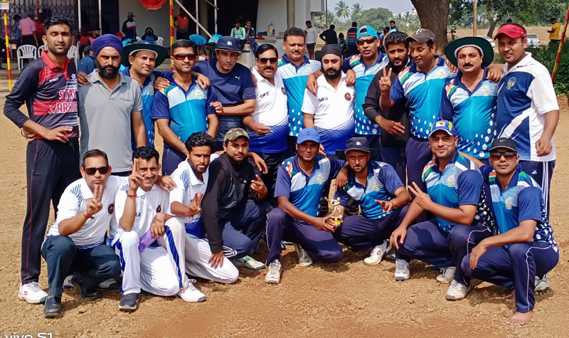 JU Employees Cricket team posing for a group photograph after defeating PU Patiala on Friday.