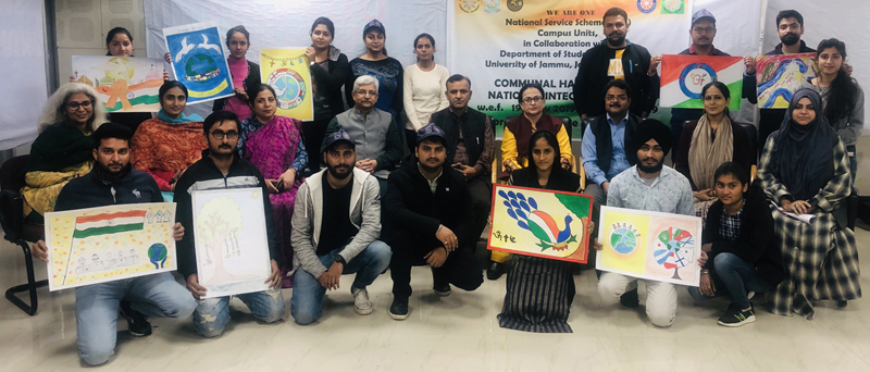 Winners of Painting Competition on 'Communal Harmony & National Integration' posing along with dignitaries and officials in Jammu.