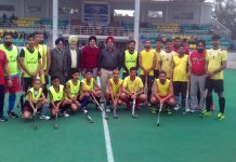 Players of Hirnanagar Hockey Club posing for a group photograph along with dignitaries and officials after entering Hockey Tournament finals.