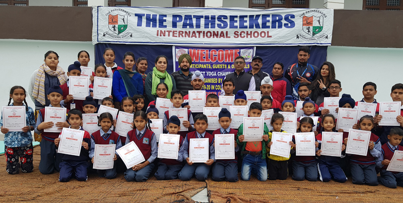 Winners of Samba District Yoga Championship holding certificates while posing for a group photograph.