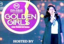 Akshita displaying singing skills during 'Golden Girls Hunt' event at Jain University in Bengaluru.