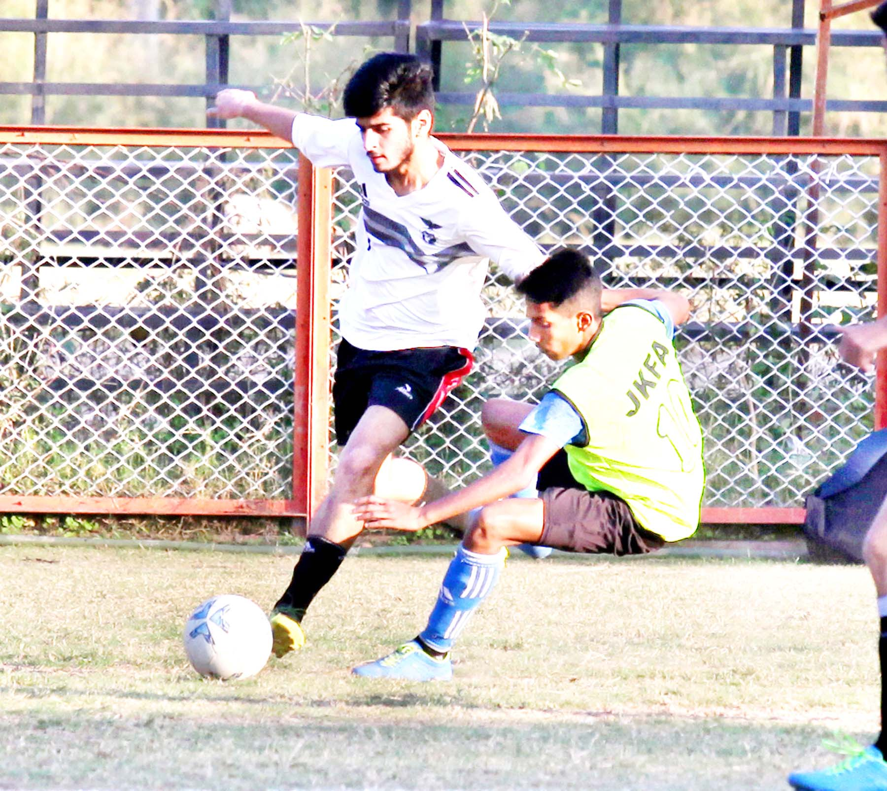 Footballers in action at GGM Science College Football ground in Jammu. -Excelsior/Rakesh