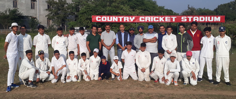 Teams posing along with the chief guest and other dignitaries at Country Cricket Club Gharota in Jammu.