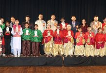 Students posing for a group photograph along with dignitaries and officials during Annual Day celebration of Springdales school in Jammu on Tuesday.
