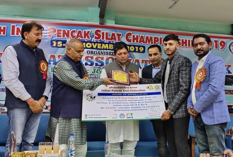 Ace Pencak Silat player Karan Chopra being honoured by IPSF in Jammu.