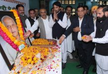 PCC chief GA Mir and others paying tributes to former Dy CM Pt Mangat Ram Sharma at a function in Jammu on Sunday. —Excelsior/Rakesh
