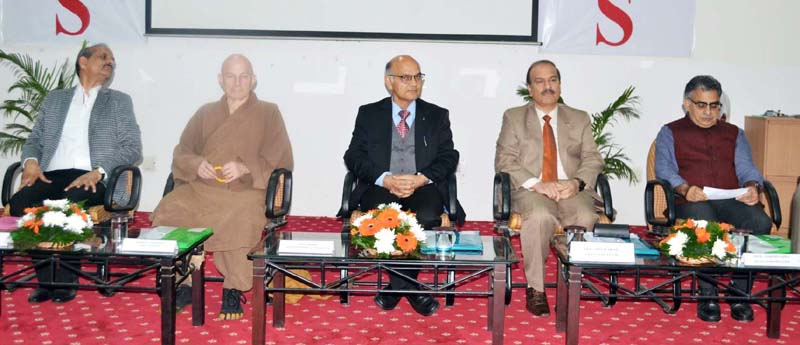 Advisor K K Sharma and others during a talk organised by JU.