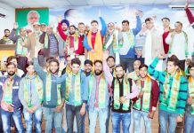 Sarpanchs and Panchs posing for a photograph with BJP State chief, Ravinder Raina at Jammu on Saturday.