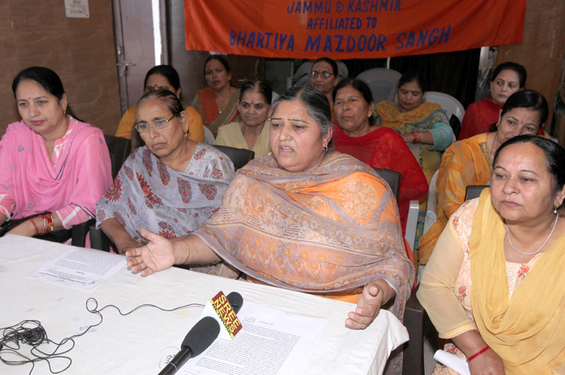 Neelam Sharma, general secretary of AWWA, addressing a press conference at Jammu. —Excelsior/Rakesh