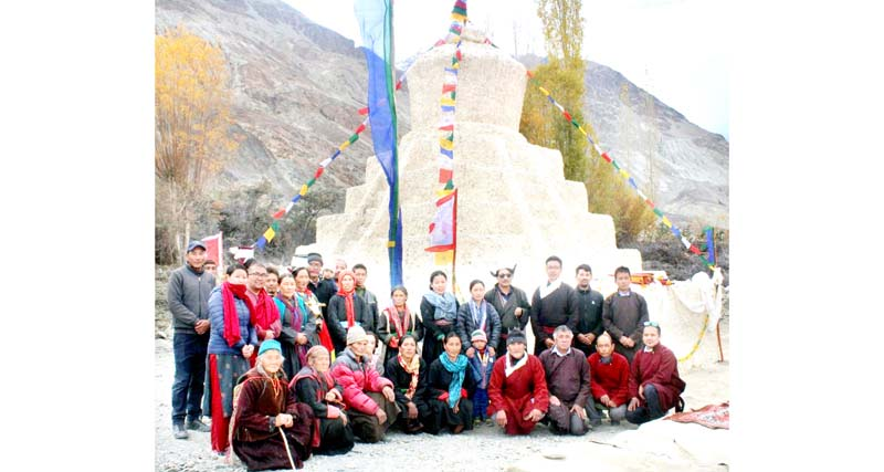 HCHF expert Dr Sonam Wangchuk and Murgi villagers posing for photograph in front of ancient stupa. -Excelsior/Morup Stanzin