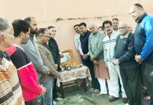 Political leaders and prominent citizens paying tributes to martyrs at Rajouri on Monday.