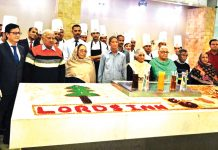 Inmates of Vridh Ashram Ambphalla during cake mixing event at Grand Plaza Lords Inn with staff of the hotel.