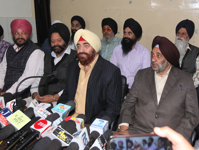 SUF president, Sudershan Singh Wazir, addressing a press conference at Jammu. -Excelsior/Rakesh