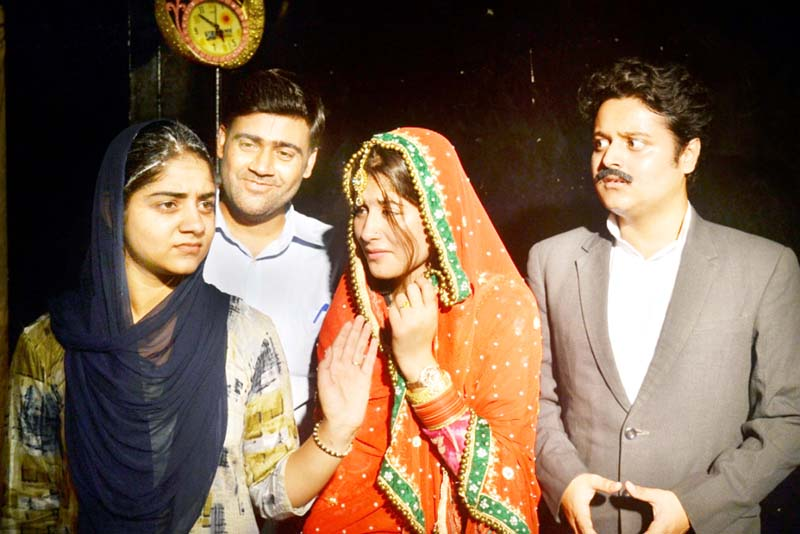 A scene from the play 'Ladai' staged at Jammu on Sunday.
