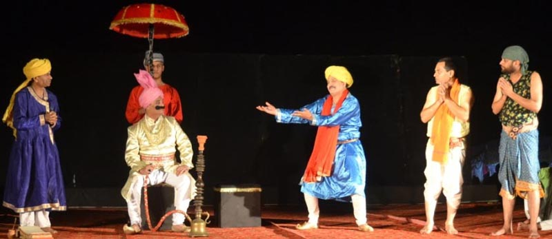 A scene from Dogri play 'Bawa Jitto' staged at Jhiri Mela on Tuesday.