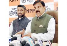 NPP chairman Harshdev Singh addressing media persons in Jammu.