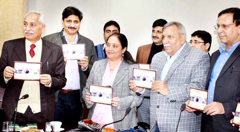 Secretary RDD Sheetal Nanda and members of Intach Jammu Chapter releasing brochure depicting the types of water bodies in Jammu district.