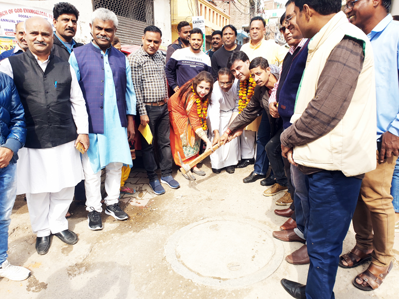 Congress leader, Vikram Malhotra kick starting construction of lanes and drains in Jammu East on Monday.