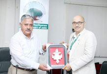 CUJ VC Prof Ashok Aima presenting memento to DRDO team head, visiting the University.