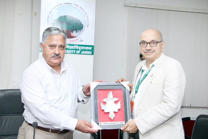 CUJ VC Prof Ashok Aima presenting memento to DRDO team head, visiting the University.