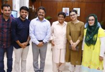 JU faculty members and scholars posing with Dr. Kiran Bedi.