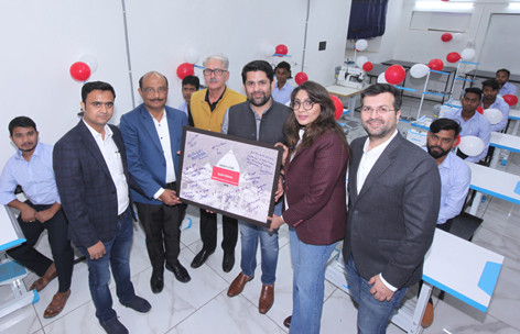 Ajit Patnaik, GM Tailoring Head along with other company officials inaugurating Raymond authorized tailoring hub in Jammu.