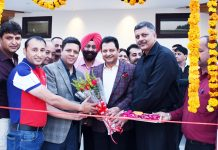 "Divisional Commissioner Jammu Sanjeev Verma inaugurating new open terrace sitting ""Cloud"" at Amar Singh Club in Jammu on Monday."