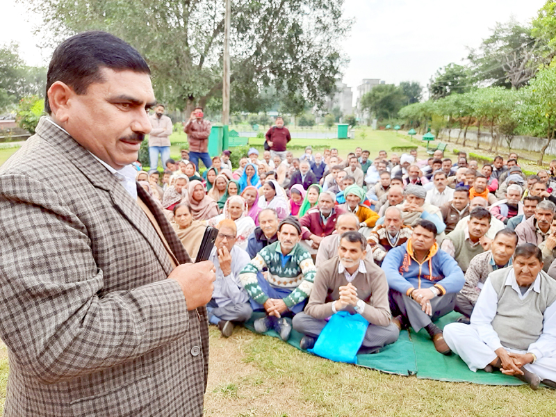 President West Pak refugees Labha Ram Gandhi addressing the gathering at Kathua on Friday. -Excelsior/Pardeep