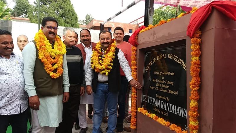 Former MLC Vikram Randhawa inaugurating lane and drain in Sector-D, Sainik Colony in Jammu.