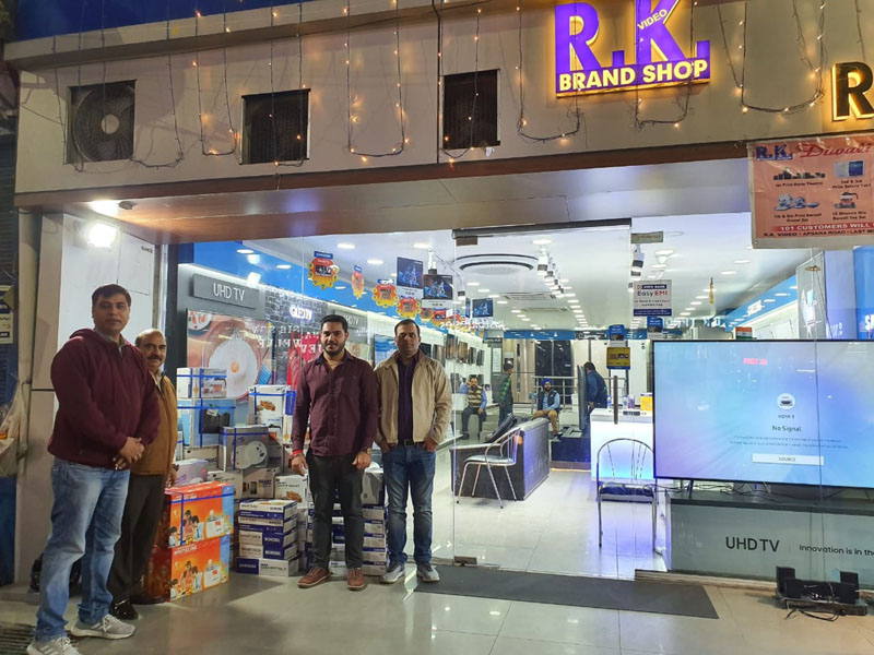 Staff of RK Video posing with Diwali Lucky Draw prizes in front of their showroom at Apsra Road, Jammu.