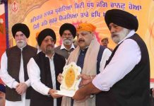 NC Provincial President Devender Singh Rana being presented memento on Tuesday.